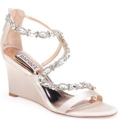 9107f6c068ab Badgley Mischka Simona Wedge Sandal in White. Sparkling crystals dazzle the  slim