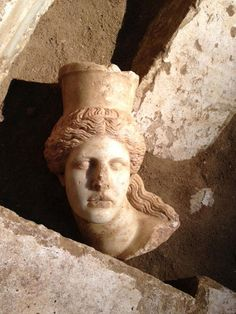 Amphipolis, Macedonia Greece: The head of the Sphinx inside the threshold - The head was found 15cm inside the marble threshold.