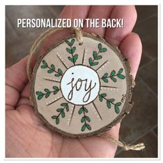 This rustic wood Christmas ornament features a pretty original wood burning on…