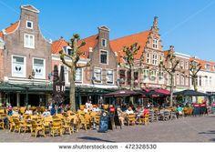 HAARLEM, NETHERLANDS - MAY 12, 2016: People enjoying vacation on outdoor sidewalk cafes on Botermarkt square in old town of Haarlem, Holland, Netherlands