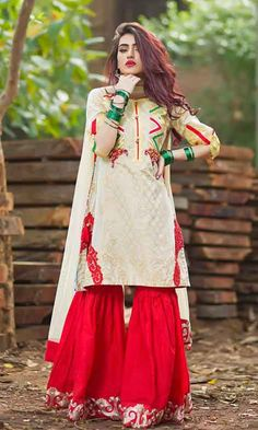 New white shirt with red gharara by Zahra Ahmad Eid dresses for girls in Pakistan Pakistani Wedding Outfits, Pakistani Dresses Casual, Pakistani Dress Design, Indian Outfits, Indian Dresses, Sharara Designs, Eid Dresses For Girl, Party Wear Dresses, Stylish Dresses
