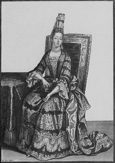 French Lady, 1695. Note the ribbon bows she is wearing amongst the lace rows of the Fontange. Jewels in her hair and hairpins. The stomacher pièce d'estomac is embroidered, engageants at the chemise sleeves with ribbons at the height of the elbow. French