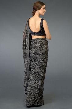 A luxurious Charcoal Grey French pure chiffon silk saree adorned with floral self colour thread embroidery all over and hand embroidered zardozi and beads highlighting on pallav and skirt. The exquisite hand embroidered floral detail is all over Bandhani Dress, Bridal Chura, Block Print Saree, Pashmina Shawl, Chiffon Saree, Printed Sarees, Saree Styles, Indian Beauty, Indian Outfits