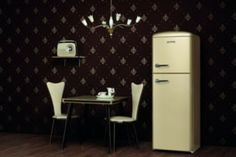 Two styles mixed for this contemporary kitchen: black & white, wallpaper, chairs and chandelier from 30s. Refrigerator from 50s