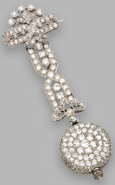 An Art Deco platinum and diamond lapel brooch/pendant-watch, Audemars Piguet…
