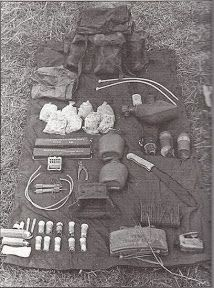 Found this on ARFCOM  - impressive amount of ordinance, including a claymore necklace...water, poncho and a whole lot of go boom gear. 1st L...
