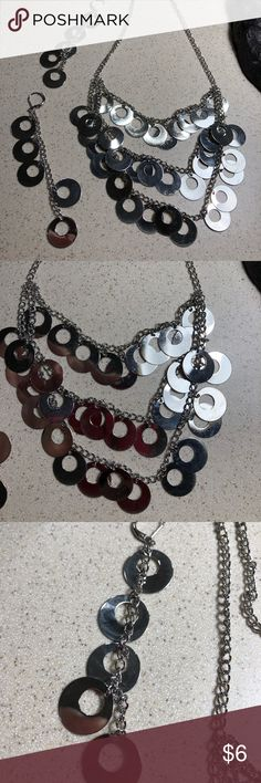 """Silver circle necklace and earrings Match set circle necklace and earrings. Necklace has 3 strands. Circles are 5/8"""" in diameter. Earrings 4"""" L.  Necklace hangs about 9"""". Does have extender chain. Jewelry Necklaces"""