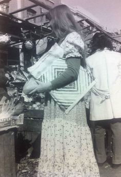 Marion, our fascinating store assistant picks up a few groceries wearing her Laura Ashley dress whilst at Chapel Street Market  http://blog.lauraashley.com/at-home/a-trip-down-memory-lane-with-marion/