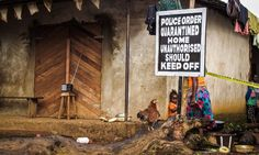 In this Wednesday, Oct. 2014 file photo, a child stands near a sign advising of a quarantined home in an effort to combat the spread of the Ebola virus in Port Loko, Sierra Leone. West Africa, Old Town, Michael Duff, Cases, Scary, Black Panthers, Articles, Morning News, Strong