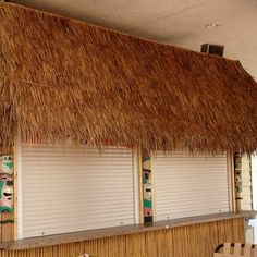 Security Shutters we recently installed on a tiki bar for a resort near Disney in Orlando, Florida. - New Horizons - Go Retractable