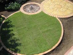 Circular lawn edging as part of round garden theme.