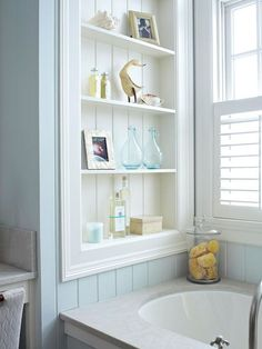 Squeeze out valuable storage without the cost of a major remodel by turning wasted space between wall studs into handy shelving units. The unused area above this tub was fitted with narrow shelves, providing ample room for soaps and other accessories. Narrow Shelves, Built In Shelves, Built Ins, Open Shelves, Corner Shelves, Floating Shelves, Small Bathroom Storage, Bathroom Styling, Bathroom Shelves
