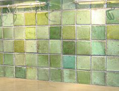 Green chunky handmade tiles.