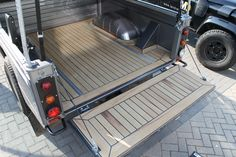 Wooden deck on Land Rover Defender 130