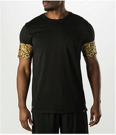 """Feel like a king in the Nike LeBron Kings Crown T-Shirt. A clean black t-shirt with a royal treatment of gold on the sleeves is detailed just like the Kings game on the court. Soft blended fabric and a great fit round out this must-have tee. Model height 6', waist 32"""" and wearing Size Large. Product sizing may vary from brand to brand. FEATURES: FABRIC: 75% polyester, 13% cotton, 12% rayon FIT: Relaxed CARE: Machine wash"""