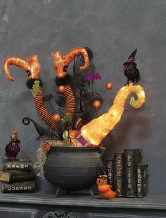 RAZ Witch Legs and Hat sticking out of an iron pot.  This is so cute!