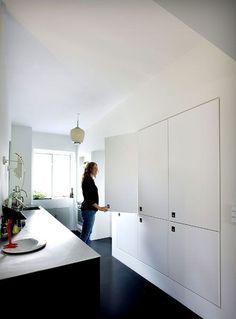 Black floors, black and white cabinets. Photo by Frederikke Heiberg