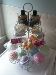 This is such an awesome idea to use a cupcake stand, don't have space at the side of your bath? This solves the problem!