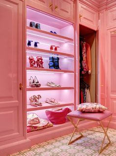 Pink walk in closet designed by Christopher Peacock.