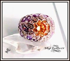 Deep set Citrine Dome ring with Amethyst. Starting at $20