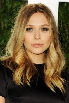 Elizabeth Olsen's makeup and hair were in perfect balance at the Vanity Fair Oscar party.
