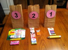 Back to school countdown  Put these circles on a brown paper bag for a 3-2-1 countdown to the first day of school.  Little treats inside each day.   Nora 2013 – 1st year of Kindergarten! Day 3 – washable dry erase markers to play school on our easel; gum Day 2 – strawberry milk straws (turns the milk strawberry when you drink milk through them); tic tacs Day 1 – colored bobby pins for her hair; rolo/Hershey kiss wrapped up to look like a school pencil