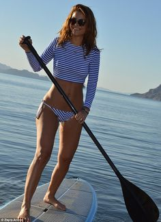 Oceans of fun: Maria Menounas stripped down to a crop top and bikini bottoms to go paddle ...
