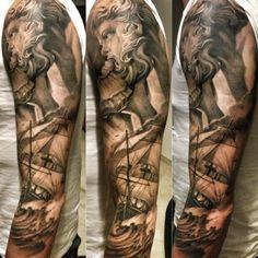 Religious ship sleeve tattoo.