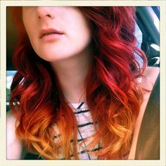 ombre red hair. i normally HATE ombre, it looks like your roots grew out. but i like this! just a tad at the bottom.
