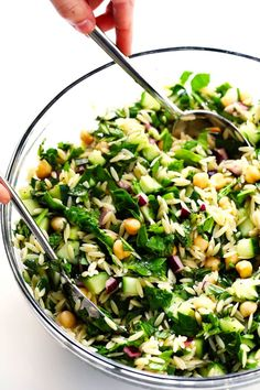 LOVE this Herb-Lovers Lemony Orzo Salad recipe! It's filled with lots of fresh basil, mint, cucumber, red onion, chickpeas, and feta. It's naturally vegetarian and vegan (if you nix the cheese). It's perfect for summer dinners and potlucks, and always a crowd fave! | Gimme Some Oven #pastasalad #orzo #potluck #vegetarian #vegan