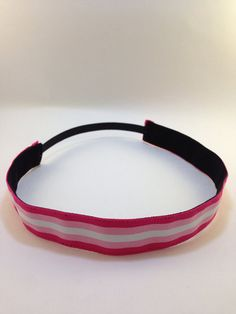 Hot pink, baby pink, & white striped non-slip headband for everyday and active wear on Etsy, $8.00