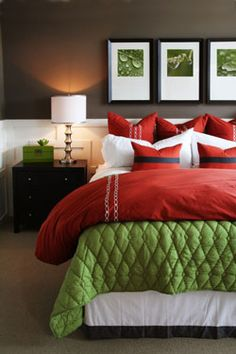 bedroom designed with white wainscotting and gray walls, and red, white and green color scheme