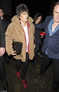 Feeling young again? Ronnie Wood performed with One Direction on the show and headed to the party with his wife Sally Humphreys