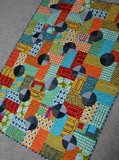 fun colors and black circles, tutorial on the site for sewing the circles with a turned edge