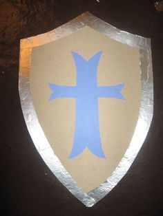 For my daughter's medieval princess/knight birthday party, I made shields as takeaways (along with tablecloth tunics and foam swords) for the boys. Here's how: Print shield shape on … Princess Birthday, Boy Birthday, Princess Party, Castle Party, Knight Shield, Medieval Party, Knight Party, Dragon Party, Vbs Crafts