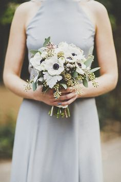 lovely clutch of white ranunculus, anemones, scabiosa pods, burgundy scabiosa, black calla lilies, seeded eucalyptus, dusty miller and silver brunia by Organic Elements