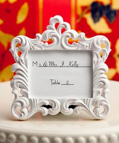 $1.12 is it white or ivory? Baroque-style frame