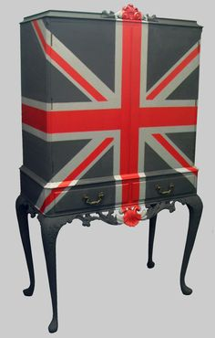 I really don't know what it is with me and Union Jack furniture, but they all seem to have me at hello ...  A Jimmie Martin piece UNION CABINET