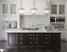 white kitchen w/ marble + dark island