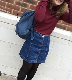 Burgundy long sleeve shirt, denim button skirt, black tights