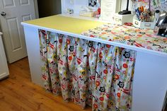 sewing area with built in ironing table , this is clever! And cute!