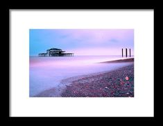 Brighton West Pier Framed Print by Marius Comanescu. All framed prints are professionally printed, framed, assembled, and shipped within 3 - 4 business days and delivered ready-to-hang on your wall. Choose from multiple print sizes and hundreds of frame and mat options.
