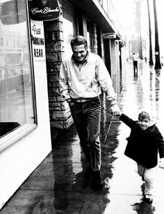 1964: Steve McQueen and his daughter, Terry, walking around Los Angeles.