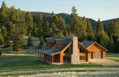 """the quintessential log cabin home""    Custom Design Log Lodge"