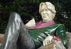 """The Oscar Wilde Memorial In Merrion Square (Dublin) 1997 by Danny Osborne The materials are granite, green nephrite jade, white jadeite and thulite. Dubliners have christened it the """"fag on the Craig"""""""