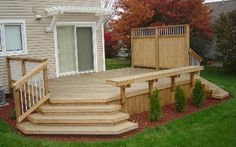 Great small deck with wide stairs to yard - needs to be stained, and the pergola needs to be larger to make it more pleasing to look at. Backyard deck with stairs Cedar Deck, Ames Backyard Fences, Backyard Landscaping, Backyard Ideas, Pergola Ideas, Patio Ideas, Backyard Seating, Simple Deck Ideas, Small Deck Ideas On A Budget, Patio Kits