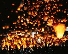 Attend a lantern festival, apparently they take place in many countries, Japan, China, Singapore, Thailand, etc.