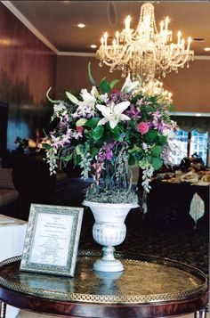 Glass Wisteria Décor add an elegant touch to this entrance design at Gray Gables by www.flowersandstuff.com