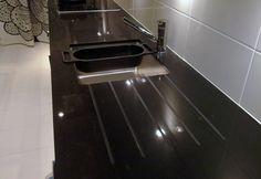 black caesarstone engineered quartz benchtop with draining board groove undermount sink