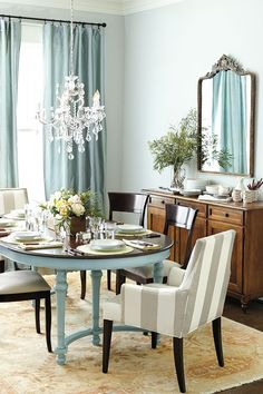 Chandelier should hang 30-36 inches above the dining table